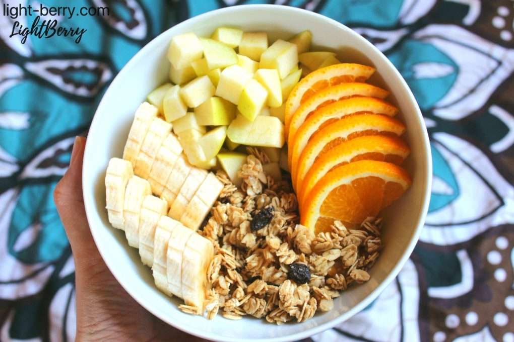 The bowl of granola with fresh fruits